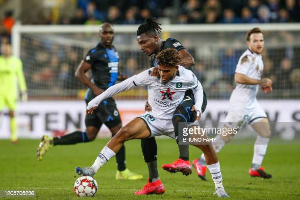 Cercle's Lyle Foster and Club's Simon Deli fight for the ball during a soccer match between Club Brugge KV and Cercle Brugge KSV Saturday 07 March...