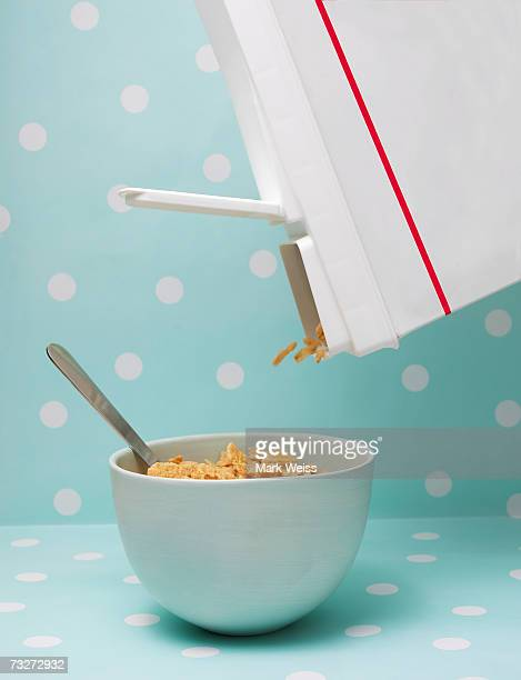 Cereal being poured into bowl