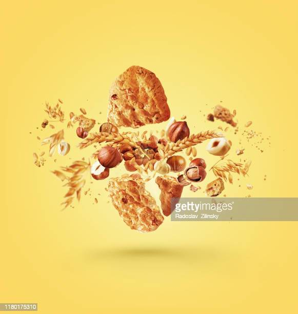 cereal biscuit cracked open full of ingredients - nut food stock pictures, royalty-free photos & images