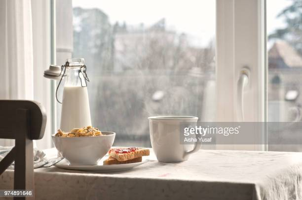 cereal, milk bottle, hot drink sandwich on table - breakfast stock pictures, royalty-free photos & images