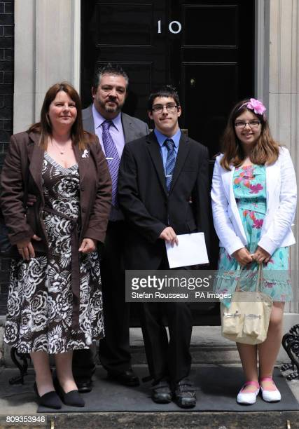 Cerebral Palsy sufferer Andrew Green with his parents Rick and Julie and sister Joanna delivers a petition to Downing St against the Justice...