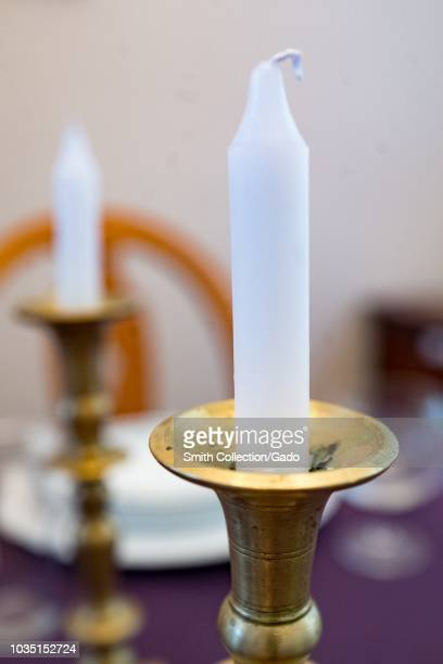Ceremonial candle holders with candles on the Jewish holiday of Rosh Hashanah two ceremonial candles are lit on many Jewish holidays including Rosh...