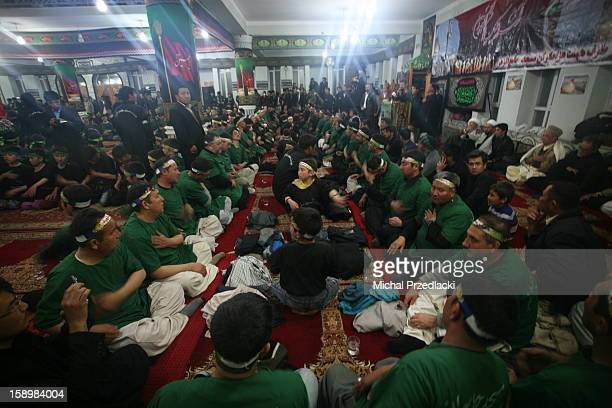 Ceremonial chest beating of Shia worshippers being a display of their devotion to Husayn, in remembrance of his suffering and to preach that...