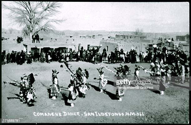 A ceremonial dance of the Comanche is depicted in this postcard shot around 1910 in San Ildefonso New Mexico