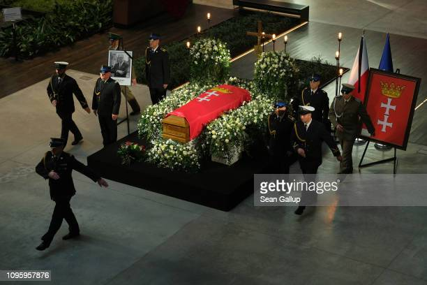 Ceremonial guards rotate as mourners pay last respects at the coffin of murdered Gdansk mayor Pawel Adamowicz at the European Solidarity Centre on...