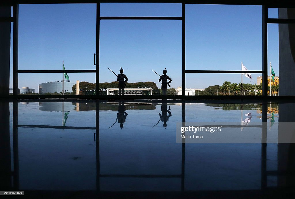 Ceremonial guards stand watch at the Planalto presidential palace a day after the Senate voted to accept impeachment charges against suspended President Dilma Rousseff on May 13, 2016 in Brasilia, Brazil. Brazil's interim President Michel Temer is holding his first offical meeting with new government ministers in the palace today. Rousseff has been suspended from her presidential duties and will face a Senate trial for alleged manipulation of government accounts.