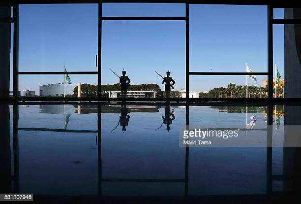 Ceremonial guards stand watch at the Planalto presidential palace a day after the Senate voted to accept impeachment charges against suspended...