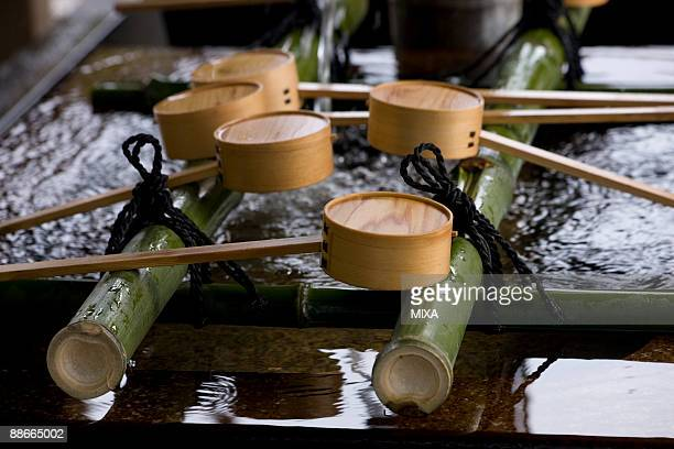 ceremonial hand washing ladles - shinto shrine stock pictures, royalty-free photos & images