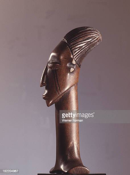 Ceremonial knife handle depicting the womens headdress and cranial modification achieved by binding the heads of babies among the Mangbetu Democratic...