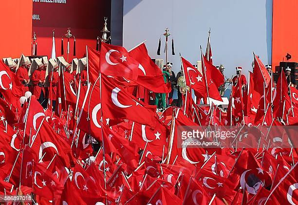 Ceremonial Ottoman Janissary Band perform as people hold Turkish flags during Democracy and Martyrs' Rally held to protest against the July 15 failed...