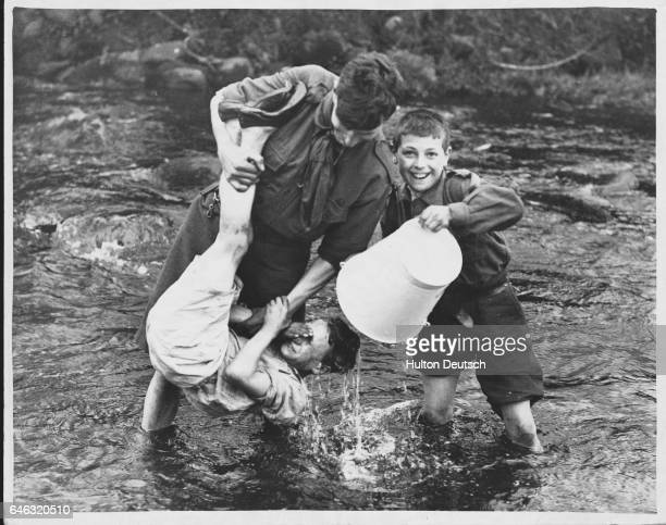 A ceremonial soaking takes place as a newcomer joins the Scouts in Yorkshire England