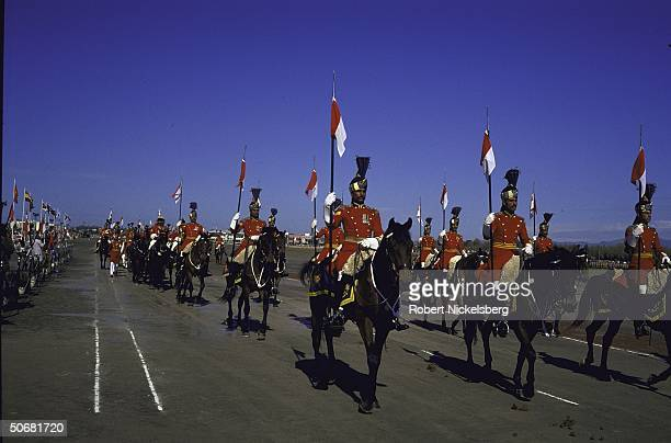 Ceremonial troops on horseback during Pakistan National Day military parade marking 1940 Muslim League declaration of intent to form separate nation