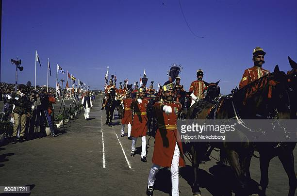 Ceremonial troops some on horseback during Pakistan National Day military parade marking 1940 Muslim League declaration of intent to form separate...