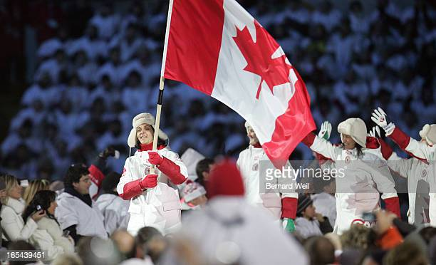 CEREMONIES02/10/06Danielle Goyette carries in the flag at Opening Ceremonies for the Torino 2006 XX Winter Olympics hosted by Turin Italy February 10...