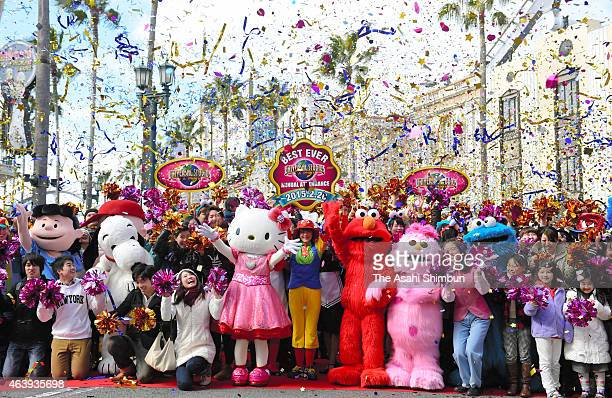 A ceremony is held to celebrate a record number of annual visitors at Universal Studios Japan on February 20 2015 in Osaka Japan The operator of...