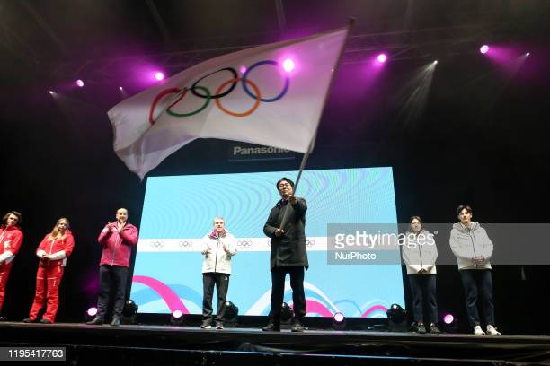 A ceremony of handing over the Olympic Flag assisted by International Olympic Committee President Thomas Bach from a Mayor of Lausanne to Korean...