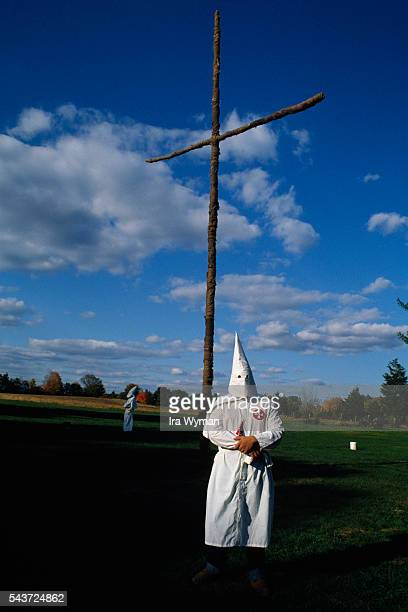 Ceremony of the Ku Klux Klan a secret militant organization that advocates white supremacy through acts of violence and terrorism Members remain...
