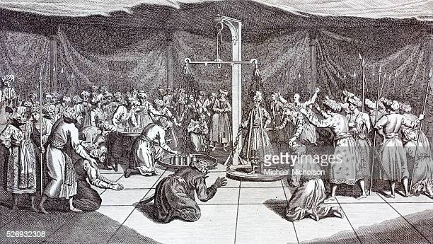 Ceremony of weighing the Great Moghul on his birthday. 19th century engraving by J. Roberts. A typical English depiction of the more glamarous and...