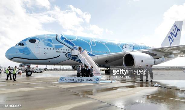 A ceremony to celebrate first delivery of Japan's All Nippon Airways Airbus A380 aircraft called the 'Flying HONU' is held after its arrival at...
