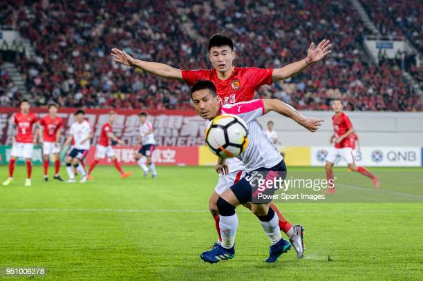 Cerezo Osaka Midfielder Atomu Tanaka in action against Guangzhou Defender Deng Hanwen during the AFC Champions League 2018 Group G match between...