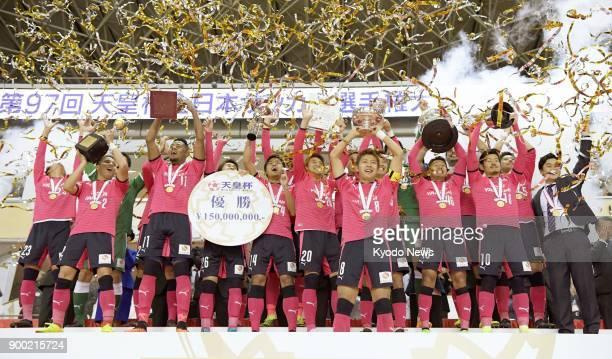 Cerezo Osaka players celebrate after defeating the Yokohama F Marinos in the Emperor's Cup final at Saitama Stadium in Saitama near Tokyo on Jan 1...