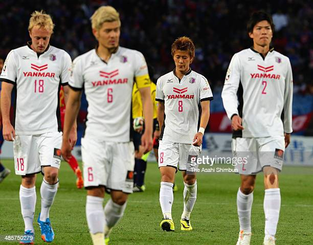 Cerezo Osaka players look dejected after losing he J.League match between F.C. Tokyo and Cerezo Osaka at Ajinomoto Stadium on April 19, 2014 in...
