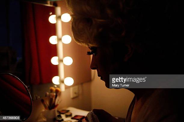 Ceri Dupree makes last minute adjustments to his makeup in his dressing room before going on stage as Princess Passionella in Sleeping Beauty at the...