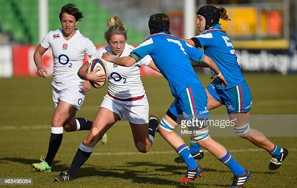 Ceri Large of England is tackled by Elisa Giordano and Alice Trevisan of Italy during the Women's Six Nations match between England Women and Italy...