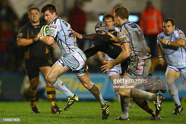Ceri Sweeney of Cardiff Blues breaks past Dave Hughes of London Wasps to score a try during the LV Cup Pool match between Cardiff Blues and London...