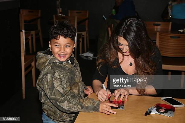 Cerina Vincent poses with fans as she promotes Disney's Stuck in The Middle at Buffalo Wild Wings Times Square on November 23 2016 in New York City