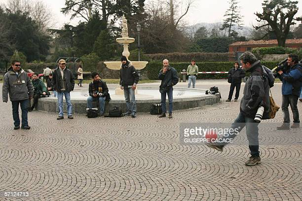 Photographers and cameramen play football on the main square in Cernobbio 18 March 2006 US film stars Brad Pitt and Angelina Jolie are rumored to be...