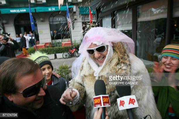 Two men dressed as a bride and groom are interviewed by journalists in Cernobbio 18 March 2006 US film stars Brad Pitt and Angelina Jolie are rumored...