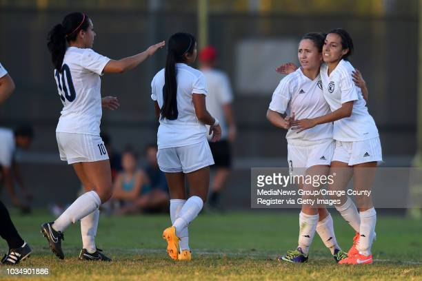Cerritos' Ashley Anaya Webb 2nd from right is congratulated by teammate on the first of her two goals against LBCC in Long Beach CA on...