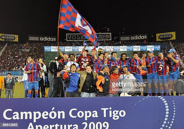 Cerro Porteno football players celebrates after being crowned champions of the Paraguayan 2009 Apertura tournament after beating 12 de octubre by 1-0...