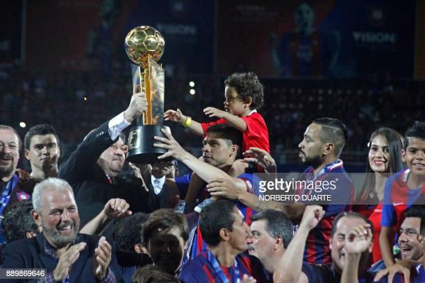 Cerro Porteno's captain Rodrigo Rojas celebrates with the trophy after winning their 2017 Paraguayan Clausura Championship final match against Sol de...