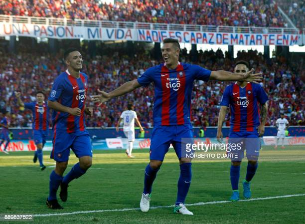 Cerro Porteno's Diego Churin celebrates with teammates after winning their 2017 Paraguayan Clausura Championship final match against Sol de America...
