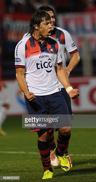 Cerro Porteno's player Oscar Romero celebrates the goal against Rentistas during their Sudamericana Cup football match at the Franzini Stadium in...