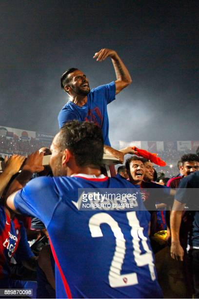 Cerro Porteno's players celebrate after winning their 2017 Paraguayan Clausura Championship final match against Sol de America in Asuncion on...