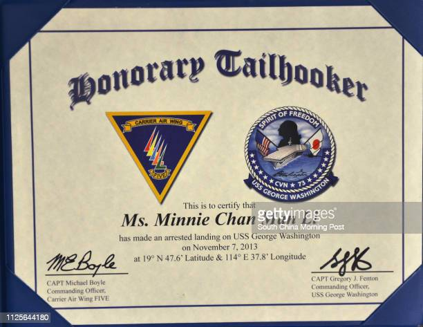 A certificate for Post reporter Minnie Chan for arrested landing on USS George Washington 07NOV13