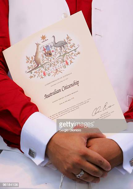 A certificate of Australian Citizenship is held by Dante Irael Flores Medina after receiving his Australian Citizenship as part of the Australia Day...