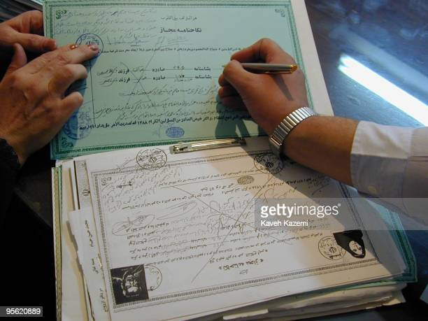 Certificates of temporary marriage filed in a registry office run by a clergyman in Tehran October 2000 Shia Islam allows a man and woman to marry...