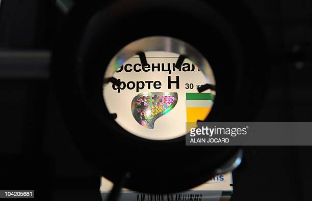 A certification hologram patch on a medicine box is seen trough an electronic microscope in a laboratory of the French pharmaceutical giant...