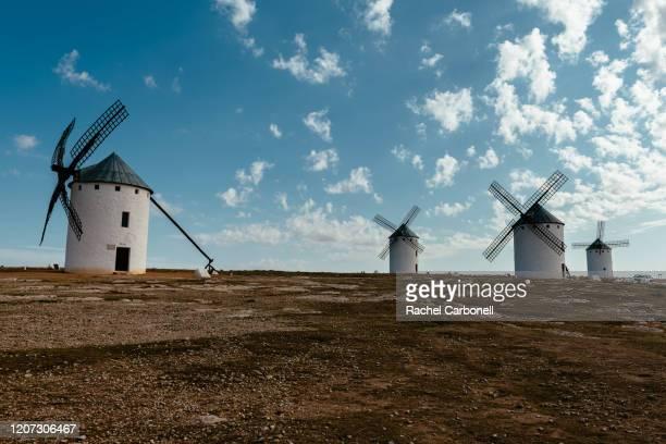 cervantes's don quixote restored spanish windmills. - castilla la mancha fotografías e imágenes de stock