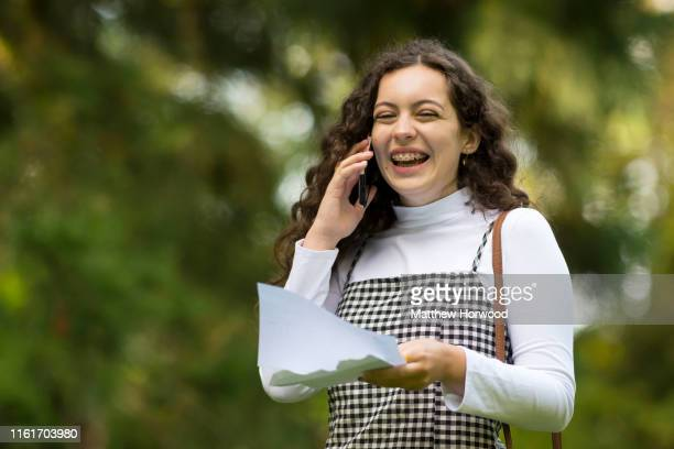 Cerys Hughes smiles while on the phone after receiving her A Level results at Ffynone House School on August 15 2019 in Swansea Wales UCAS statistics...