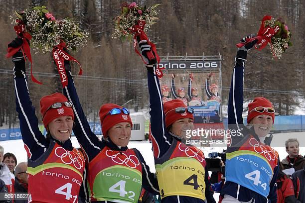 Cesana San Sicario, ITALY: France's bronze medal winning team of Delphyne Peretto, Florence Beverel-Robert, Sylvie Becaert and Sandrine Bailly pose...