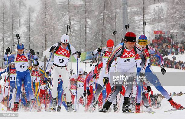 Germany's Uschi Disl leads the pack in the women's biathlon 125km mass start at the Turin 2006 Winter Olympic Games 25 February 2006 in Cesana San...