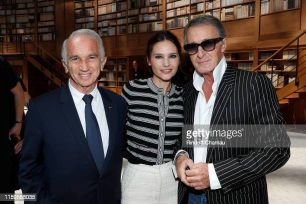 Cesar Academy President Alain Terzian actress Virginie Ledoyen and Image Director at Chanel Eric Pfrunder attend the Chanel Haute Couture Fall/Winter...