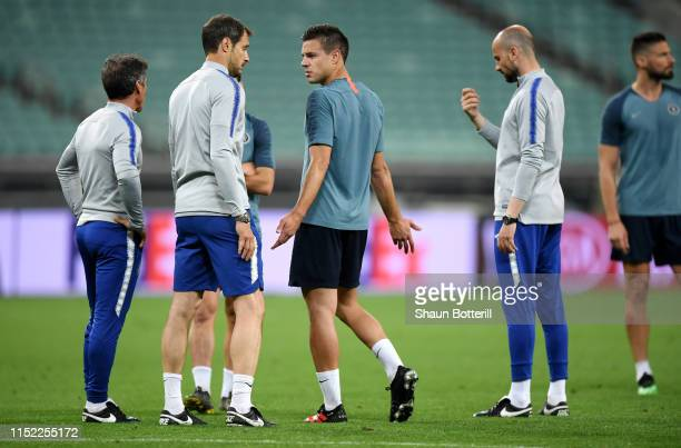 Cesar Azpilicueta and Carlo Cudicini look on during the Chelsea FC training session on the eve of the UEFA Europa League Final against Arsenal at...