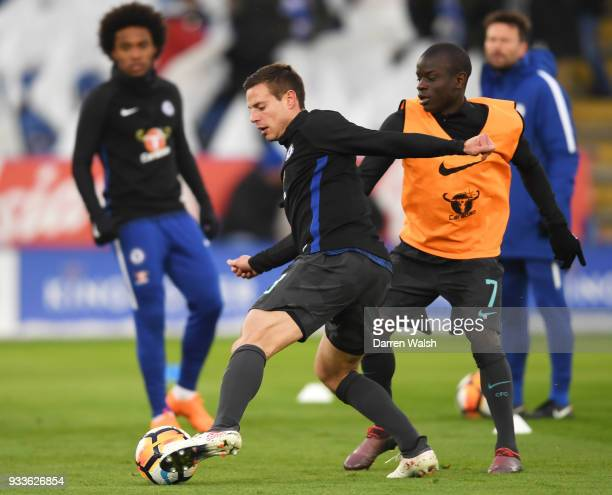 Cesar Azpilicueta and N'Golo Kante of Chelsea warm up prior to The Emirates FA Cup Quarter Final match between Leicester City and Chelsea at The King...