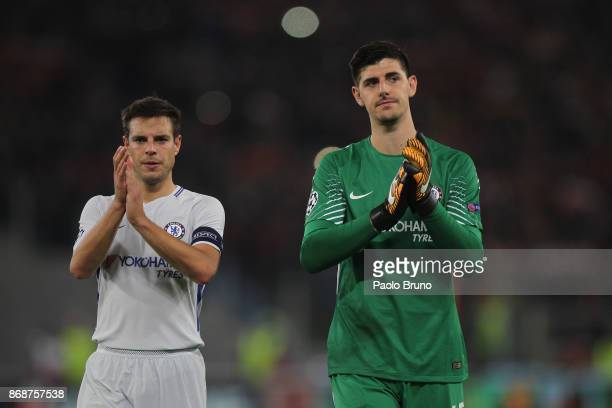 Cesar Azpilicueta and Thibaut Courtois of Chelsea FC greet the fans after the UEFA Champions League group C match between AS Roma and Chelsea FC at...